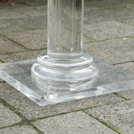 Column center table with lucite base schlicht designm bel for Cuir center table basse