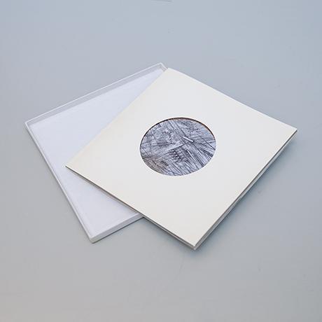 Arnaldo-Pomodoro-book-object-disk-silver
