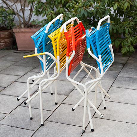 folding-chairs-blue-red-yellow-Spaghetti